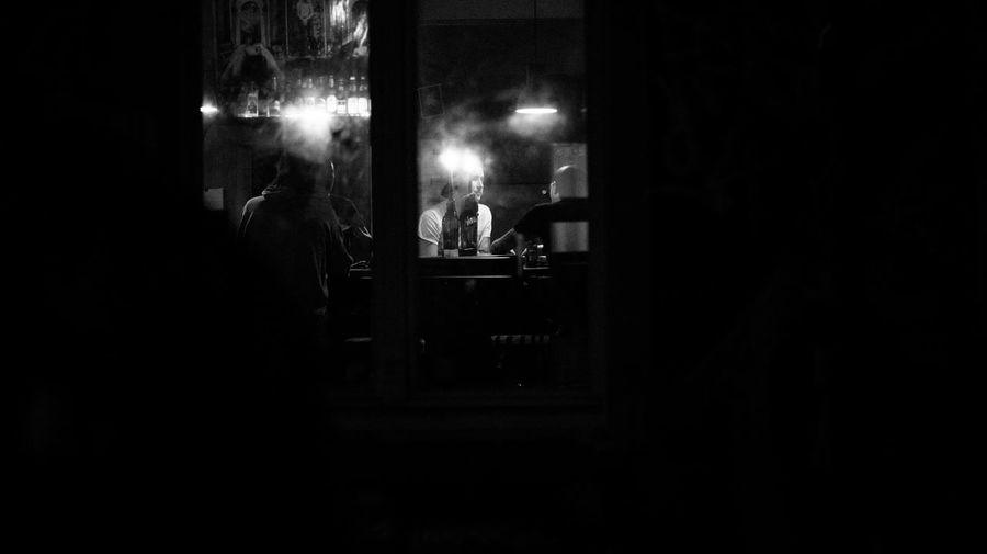 Man standing in illuminated dark room