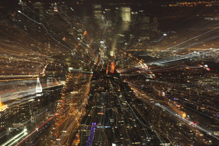 Blurred Aerial View Of City At Night