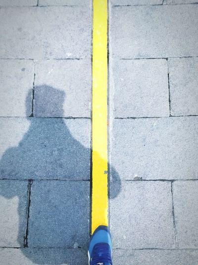 Yellow Mitad Del Mundo Quito Ecuador Lines And Shapes Balance Gravity Defygravity Human Body Part Foot Shoe Reebok Human Leg Picoftheday Eyem Best Shots Travel Destinations Shadow Paintthetownyellow Paint The Town Yellow Been There.