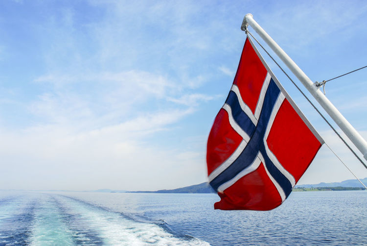The waterways in Norway Beauty In Nature Close-up Day Flag Nature No People Outdoors Patriotism Red Scenics Sea Sky Water Adventures In The City