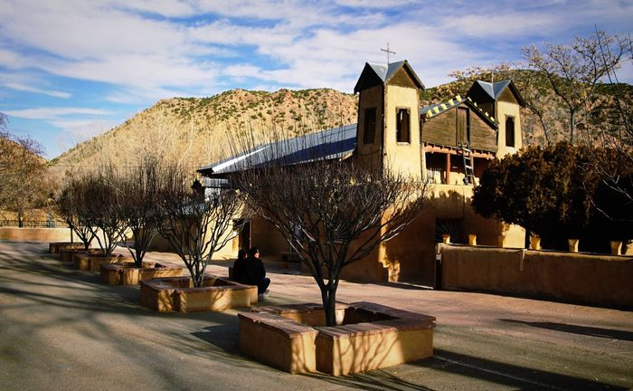 Church At Chimayo Spanish Church Church Church Architecture EyeEm Selects Built Structure Cloud - Sky Building Exterior Tree Outdoors Mountain Sunlight Day No People Nature Shadow