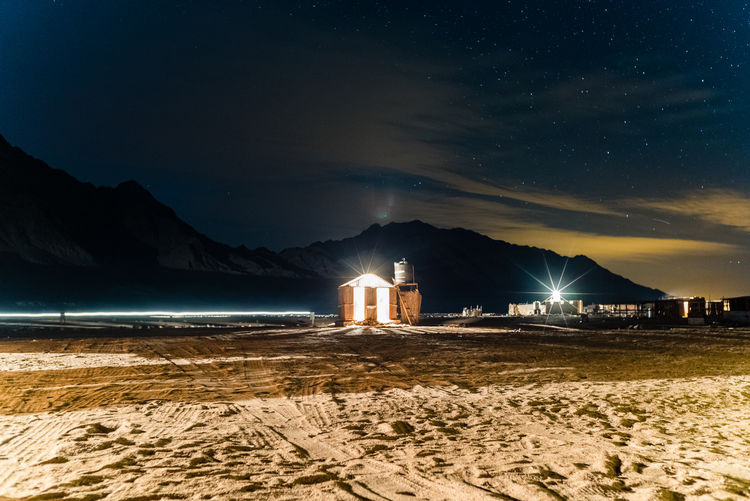 A photo series of nightscapes taken in Sinai the last week of 2016 Arts Culture And Entertainment Beauty In Nature Business Finance And Industry Igniting Landscape Nature Night No People Outdoors Scenics Sea Sky Social Issues Star - Space Water