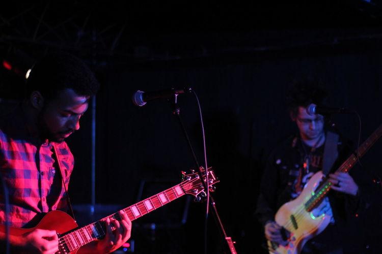 Young men performing at nightclub