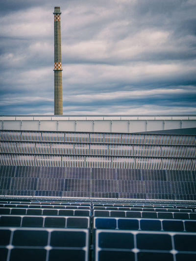 High angle view of solar panels against cloudy sky