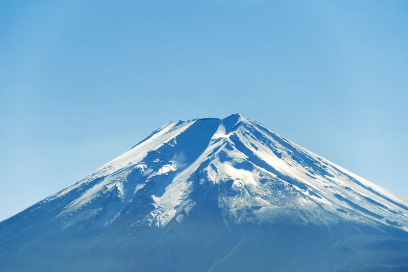Close up of Fuji mountain peak with snow cover on the top with blue sky background, Japan Volcano Fuji Mountain Fujisan Japan Fujikawaguchiko Mountain Hills Landscape Nature Travel Peak Sky Snow Cold Temperature Blue Winter Scenics - Nature Snowcapped Mountain Beauty In Nature Tranquil Scene Clear Sky Mountain Peak Tranquility No People Copy Space Mountain Range Non-urban Scene Day