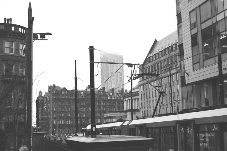 Battle Of The Cities Manchester UK Old Building  New Building  Architecture Built Structure Sky Urban Skyline No People New Trams Old Roads New Building Old Building Rainy Day Overcast Cloud