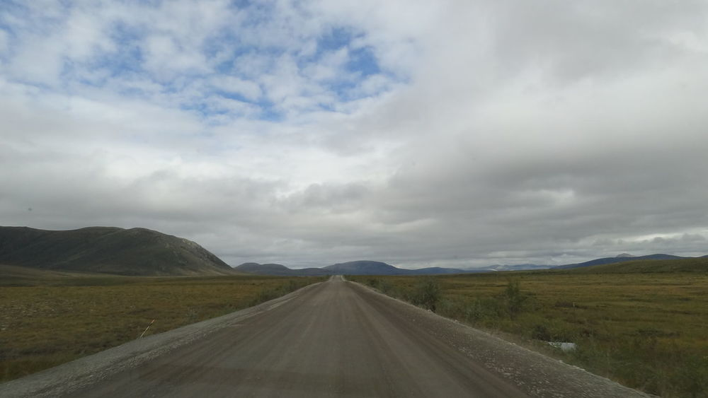 Beauty In Nature Canada Cloud - Sky Day Dempster Highway Diminishing Perspective Highway Landscape Nature No People Outdoors Road Scenics Sky The Way Forward Tombstone Territorial Park Tranquil Scene Tranquility Transportation Yukon