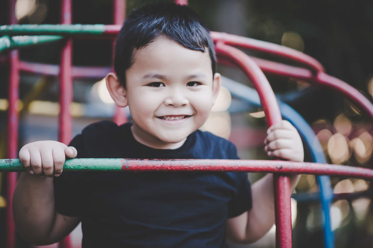 Portrait Of Smiling Boy Playing At Playground