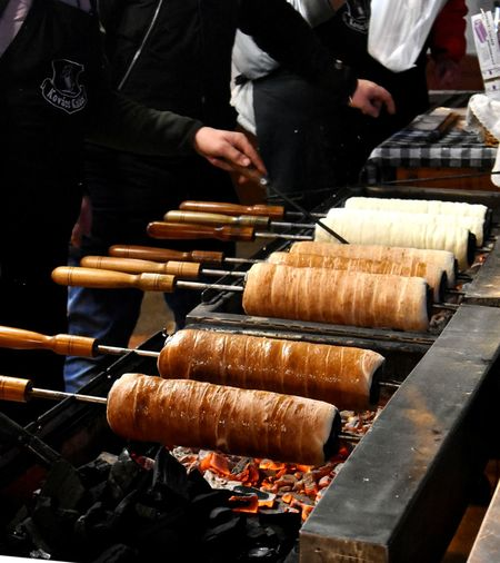 Hungarian food which called kürtös kalács. It is a chimney cake, which contains sugar. Massive carbohydrate but it is really unique. Desert Real People Food Hungary Barbecue Christmas Tradition Chimney Food And Drink Chef Streetfood Preparing Food Business Preparation  Christmas Fair Freshness Unique Sweet Food Skewer Kürtöskalacs Hungarian Food Focus On Foreground Kurtos Kalacs Chimney Cake Carbohydrate - Food Type Preparation