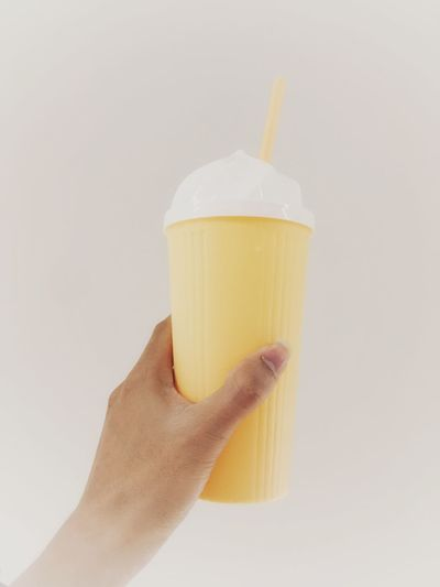 Food Drink Glass Sweet Ice Cream Frozen Hand Yellow Food And Drink Indoors  Freshness Close-up White Background Holding Sweet Food Studio Shot Frozen Food One Person Human Hand Water Jar Unrecognizable Person Human Body Part Unhealthy Eating Personal Perspective Hold A Glass Of Water