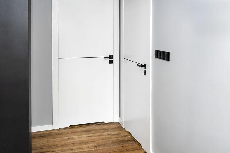 Directly below shot of building with closed door