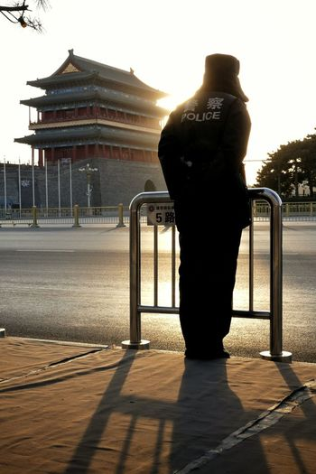 Showcase March Tiananmen Square Beijing China Policeman Sunset Silhouettes Sunset Zhengyangmen People Watching People Police Streetphotography Traveling Travel Photography Travel Schattenspiel  Light And Shadow Creative Light And Shadow Shadow Tian'anmen Square Up Close Street Photography Telling Stories Differently People And Places Original Experiences The City Light An Eye For Travel
