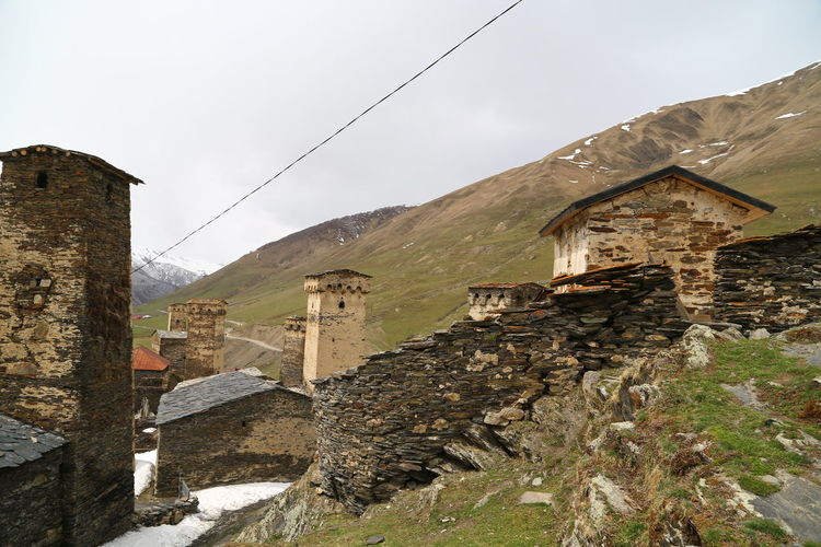 Architecture Built Structure Building Exterior Building Sky Old Mountain House Nature No People History Day Outdoors Wall Stone Wall Residential District The Past Damaged Landscape Environment Ancient Civilization Georgia Mestia/town In Svaneti/Georgia