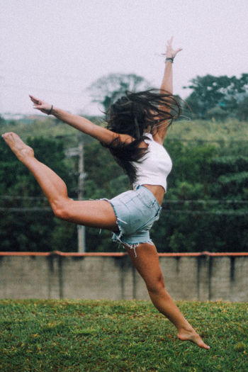 50mm Bailarina Girl Power The Week On EyeEm Arms Raised Canon Canonphotography Day Full Length Fun Girl Glittering Jumping One Person Real People Young Women Inner Power Be Brave