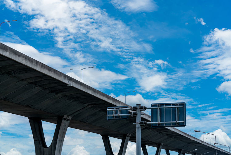 Low angle view of elevated road against sky