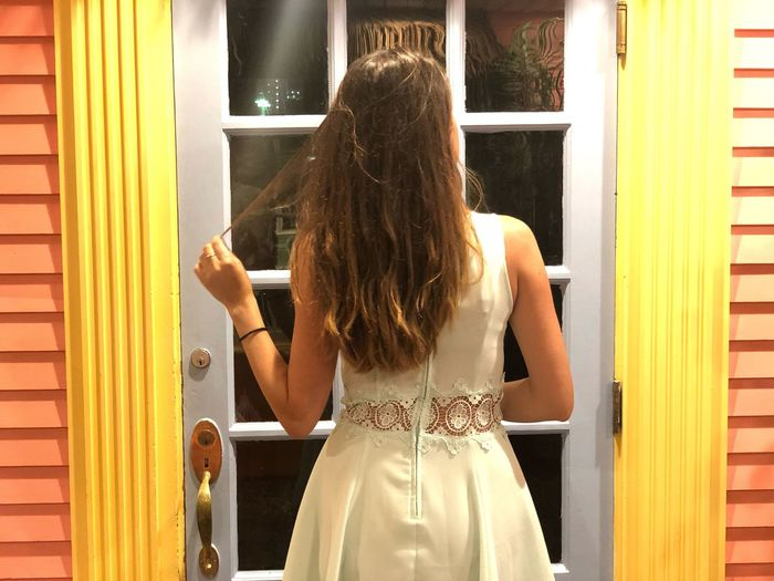 EyeEm Selects Rear View Women Lifestyles Adult One Person Hairstyle Fashion Young Adult Human Hair Leisure Activity Indoors  Real People Yellow Casual Clothing Window Teenager Hair Waist Up Standing Day The Traveler - 2018 EyeEm Awards HUAWEI Photo Award: After Dark
