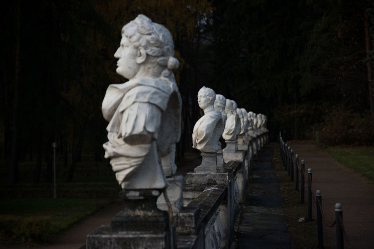 Statues in row at park