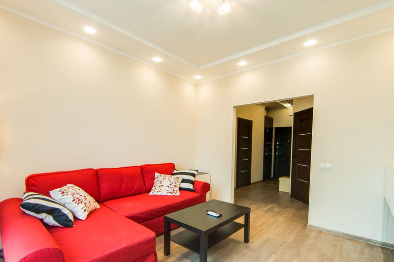 Red Pillow Indoors  Furniture Home Interior Domestic Room Cushion Lighting Equipment Architecture Flooring Stuffed Living Room Home Showcase Interior Absence No People Modern Sofa Built Structure Wealth Wall - Building Feature Luxury Electric Lamp Clean