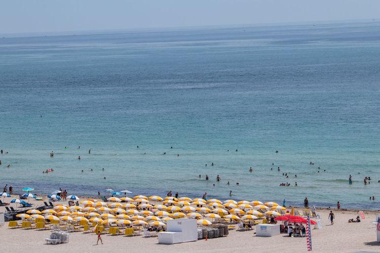 Miami South Beach Miami Miami Beach Beach Beach Umbrella Beachphotography Group Of People High Angle View Horizon Horizon Over Water Land Leisure Activity Nature Outdoors Sea Sky Umbrella Vacations Water