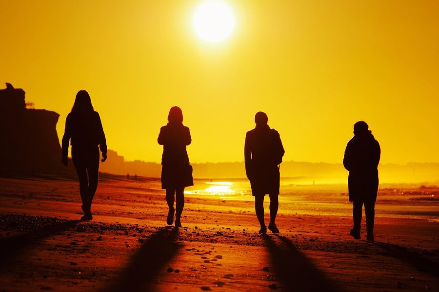 Four ladies on a mission. (1/3200s, f/9.0, EV0, ISO200, 200(300)mm) Dawn Silhouette Beach Sunrise Sunlight Burning Mission Mystery Sea Sun Morning Another World Beware Light And Shadow Attitude Exceptional Photographs Girl Power Yellow Morning Light Yellow Sky Fight For Your Right Sunbeam Wild West Sky Edited On IOS Pentax K-3