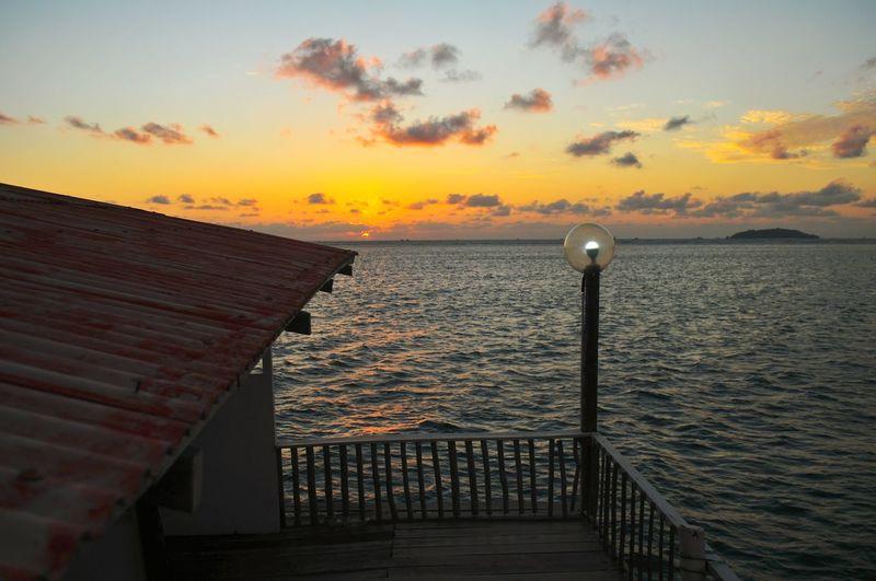 EyeEm Selects EyeEmBestPics Mood Orange Illustration Warm Summer Sunrise_sunsets_aroundworld Sunrise Silhouette Lamp Lamp Post Morning Light Morning Water Sea Sunset Beach Harbor Horizon Cityscape Sky Horizon Over Water Cloud - Sky Seascape