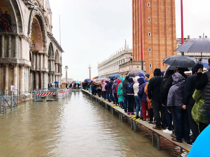 Venice, October 30, 2018. St. Mark's Cathedral. Flood in Venice. Line to the Cathedral. High Water In Venice People Walked Autumn 2018 Weather Venice Water_collection High Water Level High Water Aqua Venice, Italy Building Exterior Group Of People Architecture Built Structure City Large Group Of People Crowd Real People Water Day Street Building Rainy Season Outdoors Sky Rain Wet Nature Men Architecture The Art Of Street Photography