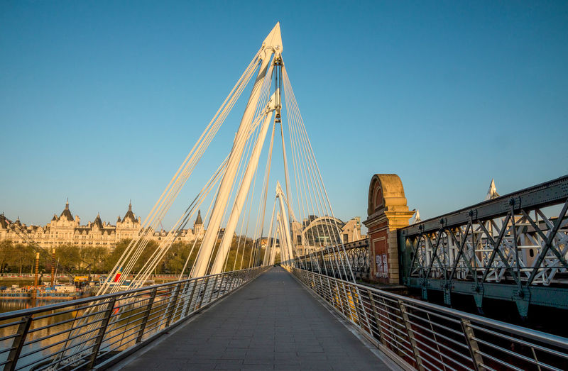 Golden Jubilee and Hungerford Bridges in London early in the morning, London, England Across City Golden Great Britain London Road Sightseeing Thames United Kingdom View Walk Bridge Cable Capital City England Gardens Hungerford Jubilee Pedestrian River Spot Travel Destination Visit Walkway