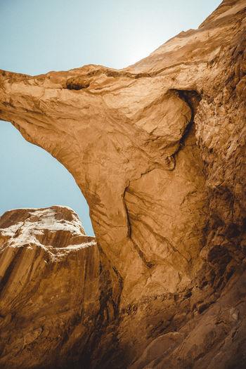 Rock formation in desert against sky