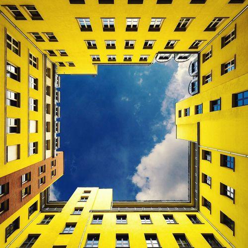 Directly below shot of quartier schutzenstrasse against sky