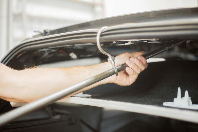 Close-up of man repairing car