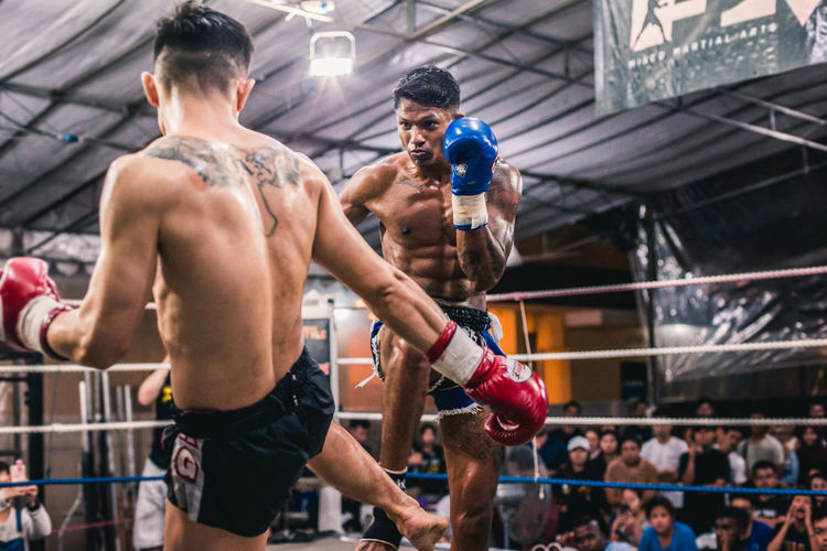 Alvin Vs. Ian (II) Aggression  Effort Punching Boxer People Motion Boxing - Sport Boxing Glove Sportsman Young Men Young Adult Competitive Sport Vitality Boxing Ring Men Strength Adult Determination Competition Muscular Build Athlete Sport Shirtless Muay Thai Fighting Fighters The Traveler - 2019 EyeEm Awards