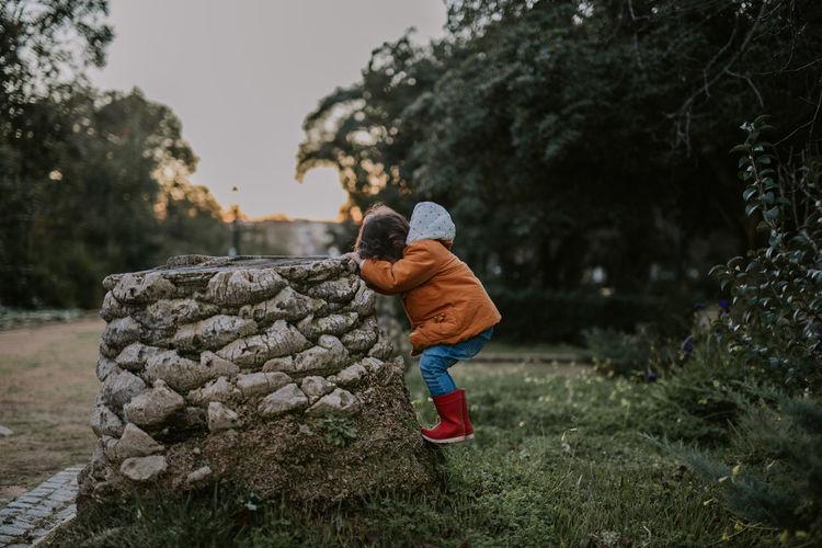 Full length of boy standing on land