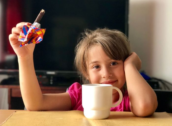 Drink Childhood Child Food And Drink Front View Portrait Refreshment Girls Drinking Looking At Camera Cute Real People Holding Innocence Milk One Person Table Lifestyles Drinking Glass Headshot