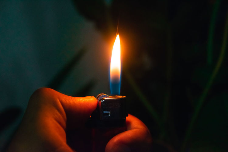 Fire source Fire Burning Flame Fire - Natural Phenomenon Hand Heat - Temperature Holding Cigarette Lighter Real People Finger Human Finger Igniting Close-up Unrecognizable Person Glowing Dark Lighter Kindle Fire Origins Fire Fireworks
