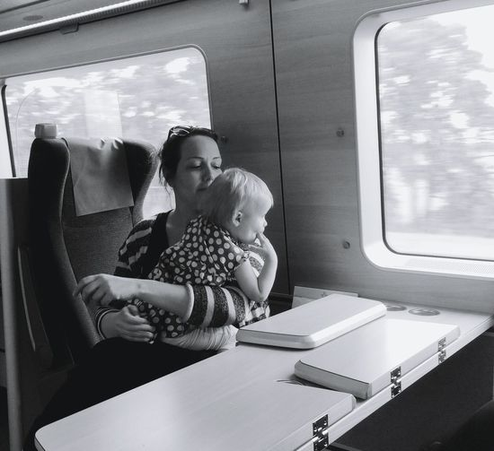 Traveling Travel Train Travelphotography Hanging Out Girl Mother & Daughter Motherhood Black And White Collection  Peoole People Photography Blackandwhite Photography Black&white Blackandwhite EyeEm Gallery In The Moment Childhood Edventure  People Together From My Point Of View Transportation The Street Photographer - 2017 EyeEm Awards This Is Family Children Primary Age Child Train Interior Passenger Train Public Transportation Rail Transportation My Best Photo Humanity Meets Technology Moms & Dads The Traveler - 2019 EyeEm Awards The Mobile Photographer - 2019 EyeEm Awards