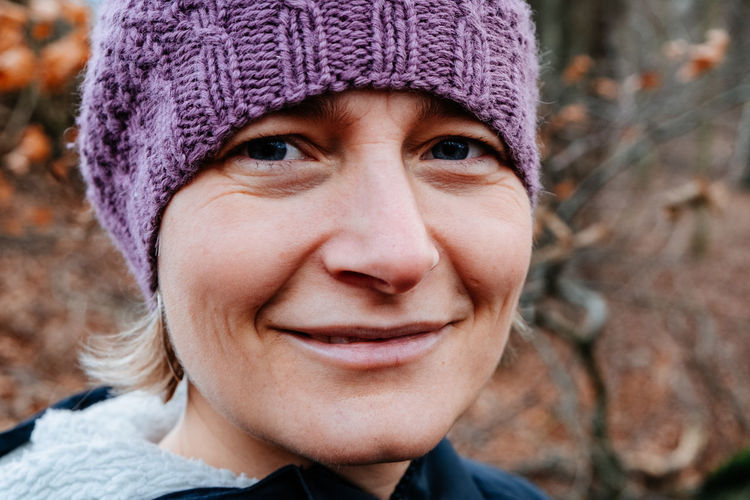 Portrait Headshot Hat Smiling One Person Winter Knit Hat Adult Happiness Close-up Purple Beautiful Woman Emotion Women Looking At Camera Autumn Fall Outdoors Nordic Forest Warm Clothing Cold Temperature