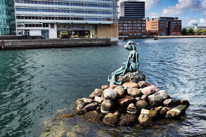 Den Genmodificerede Lille Havfrue Atlas Obscura Copenhagen Sights Little Mermaid  Architecture Built Structure Building Exterior City Water Building Nature