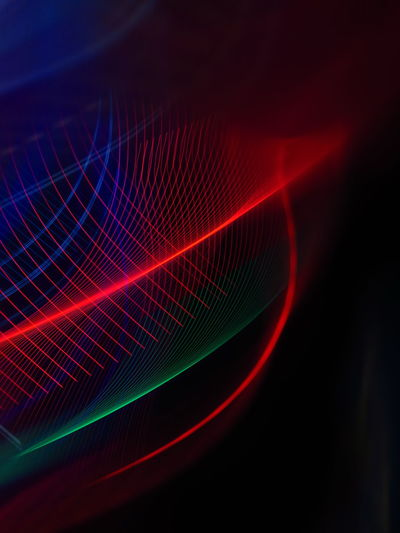 Close-up of light painting against abstract background