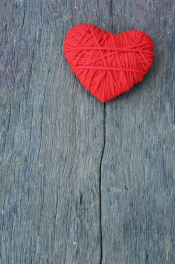 High angle view of heart shape wool ball on table