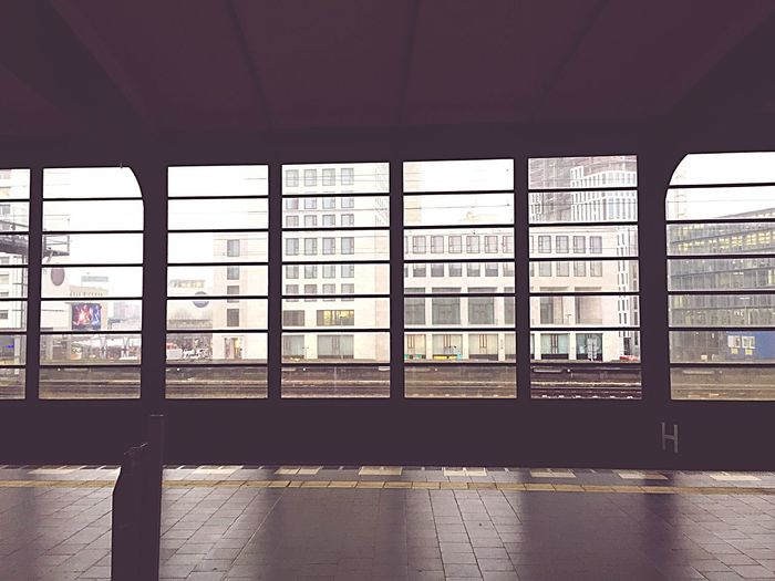 Buildings Seen Through Glass Window At Metro Station