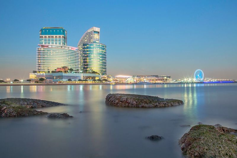 City of festivals City Longexposurephotography Longexposure Landscape_photography Dubai Water Sky Architecture Building Exterior City Built Structure Reflection Nature Illuminated Building Modern Skyscraper Travel Destinations Outdoors Sea Clear Sky Blue Cityscape