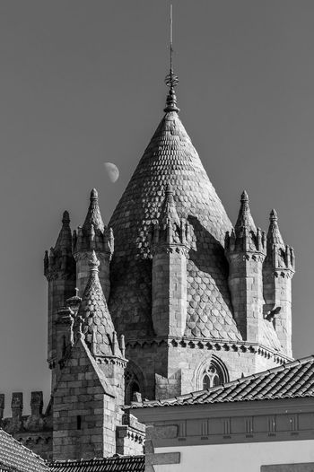 Castle Evora, Portugal Portugal Postcard Architecture Blackandwhitearchitecture Building Exterior Built Structure Castletower Castletown Clear Sky Day Low Angle View No People Outdoors Place Of Worship Postcardfromtheworld Religion Risingmoon Sculpture Sky Spirituality Statue Stone - Object Tower