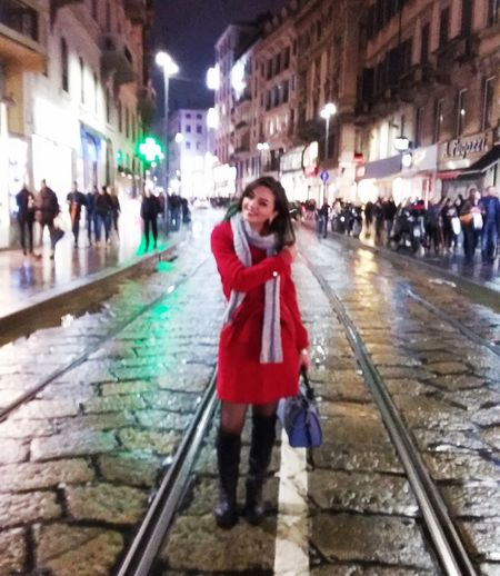 City Full Length Night Red Wet Built Structure Architecture Outdoors Happiness Standing Women Leisure Activity City Life Real People Portrait Smiling Motion Illuminated Woman In Red Woman In Red Coat Woman On Street Red Coat Streetphotography