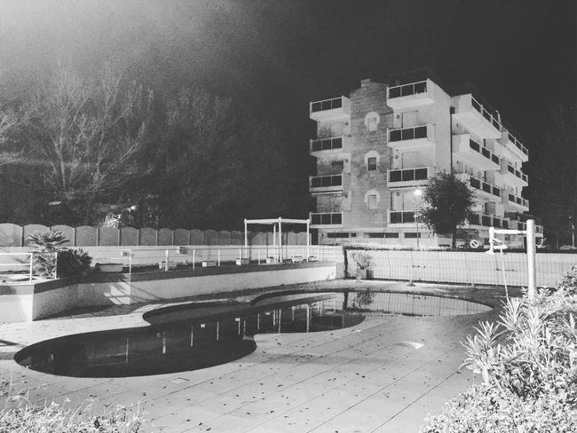 AsSenza d'estaTe. Inverno Adriatico Photocuba Rimini Hotel Black And White Monochrome Swimming Pool Outdoors Solitude Nightphotography Night Architecture No People Bn Black & White Vision Puntidivista Italy