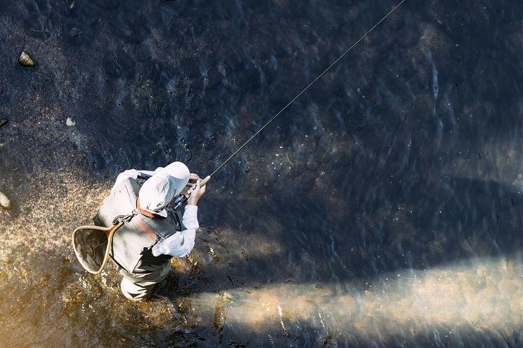 Man fishing in water