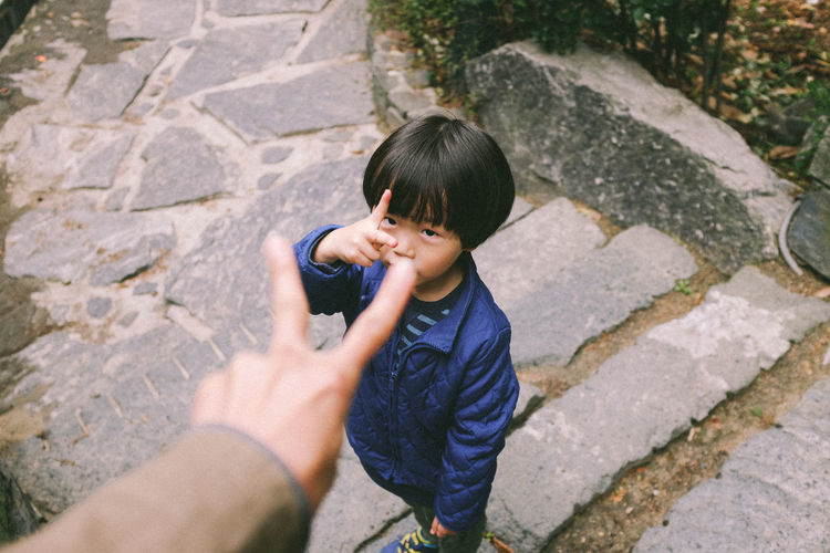 Playing Rock-paper-scissors with my son EyeEm Korea Kids Hand Hanging Out