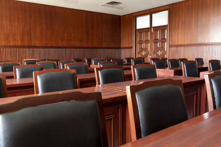 Empty chairs and tables in courtroom