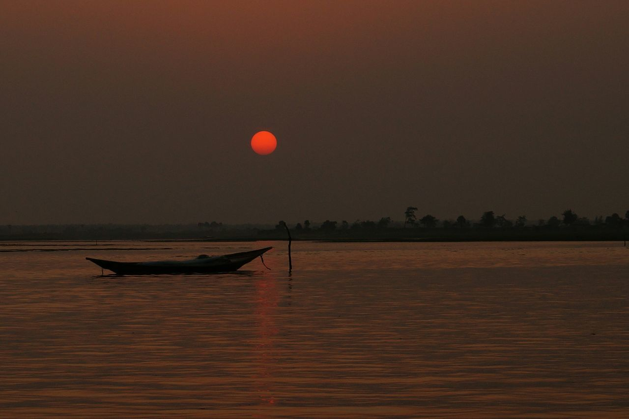 sunset, water, waterfront, nautical vessel, tranquil scene, transportation, nature, mode of transport, scenics, river, tranquility, beauty in nature, outdoors, red, sky, moon, clear sky, no people, day