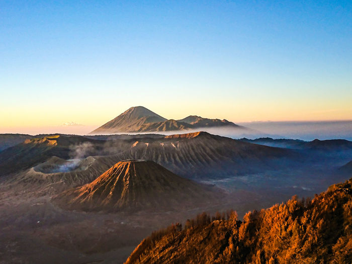 Bromo EyeEm Indonesia EyeEm Best Shots Cloud - Sky Cloud Cloudy Blue Sky Clouds And Sky Tree Mountain Sunset Snow Clear Sky Winter Blue Sky Landscape Mountain Range Volcanic Landscape Physical Geography Rocky Mountains Geology Volcanic Crater Bromo-tengger-semeru National Park Mountain Peak Hot Spring Rock Formation Sulphur