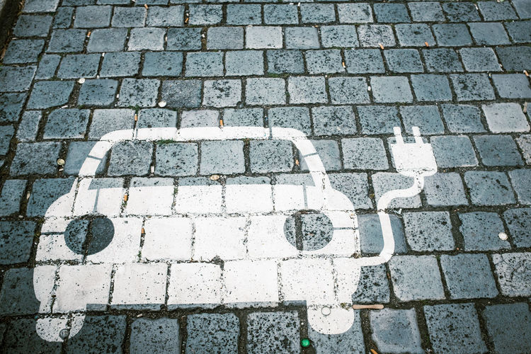 Automobile Cobblestone Streets Modern Traffic Car Clean Climate Day Economical Electricity  Energy Industry Environment Future Grey Innovative Lasting Loading No People Outdoors Power Cable Power Line  Power Plug Power Supply Recycling Street Traffic Sign